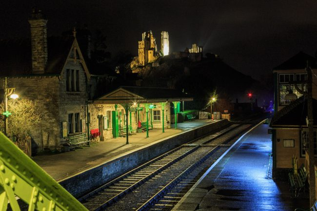 Deserted railway station with the castle behind