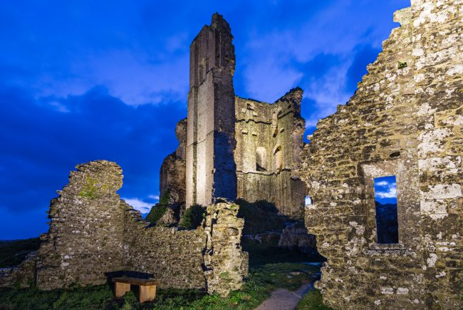 Corfe Castle ruins at dusk