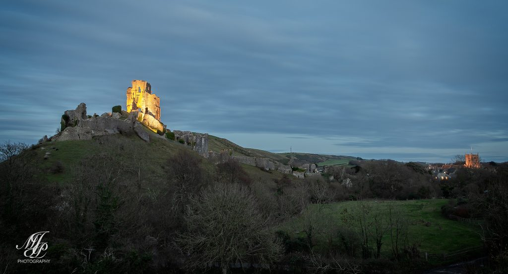 Corfe Castle and village at dusk